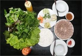 Combo 1 phần thịt bắp giò + 1 đĩa rau rừng + 1 dĩa bún, chuối, khế, dưa leo + 1 dĩa bánh tráng + 2 chai Pepsi tại Nhà hàng Đông Hoa